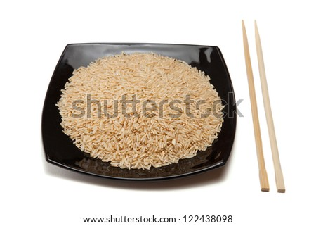 Rice in a black plate and chopsticks; isolated on white - stock photo
