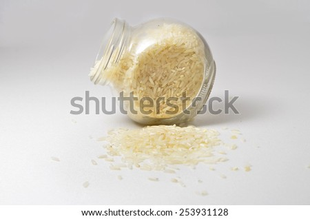 Rice in a glass container. Shoot over white background. Shallow depth of field. Focus on the important part.