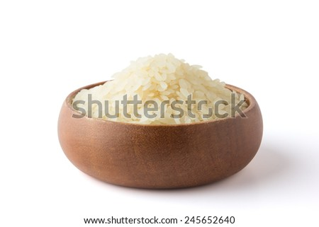 Rice in a wooden bowl.  With Clipping path. - stock photo