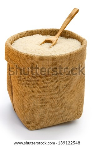 rice in gunny with a wooden spoon - stock photo
