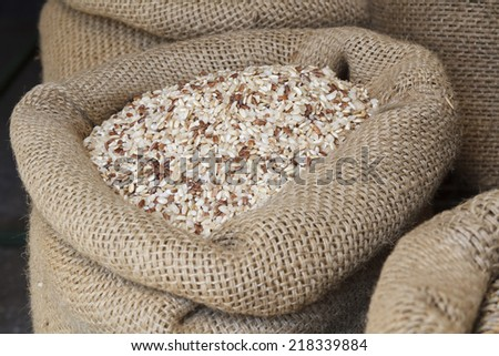 Rice in jute sack - stock photo