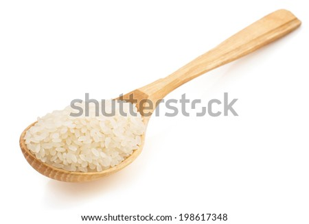 rice in wooden spoon on white background - stock photo