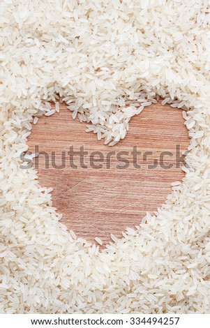 rice lying on a wooden board in the form of heart