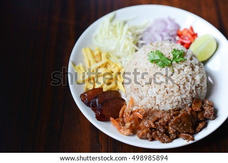 Rice mixed with shrimp paste and side dish as a mango,lime,Chinese sausage,dried shrimp,chili,shallots,pork and scrambled egg.Shrimp paste is a common ingredient used in Southeast Asian cuisine.