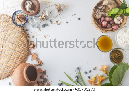 Rice Noodles in sweet curry sauce/ Traditional Thai cuisine, rice vermicelli served with boiled egg , sweet peanut sauce and vegetable on wood table.Selective Focus. - stock photo