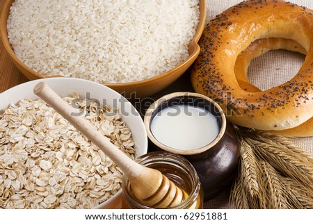 rice, oat, honey, milk and spike on sacking