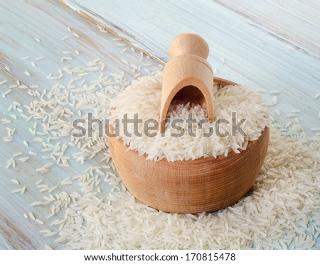 Rice  on a wooden table. Selective focus - stock photo