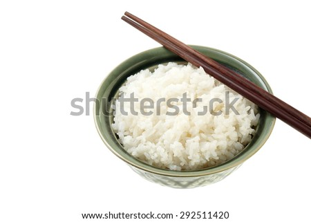 Rice on green Bowl with wood chopsticks isolated on white background - stock photo