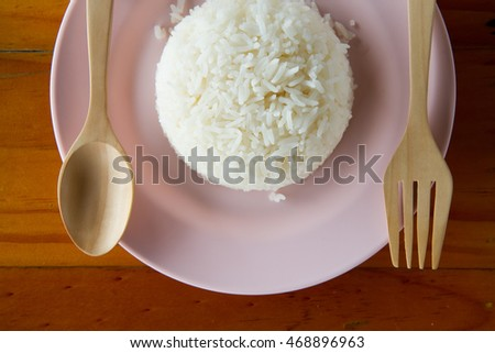 rice on soft pink dish on wooden table