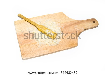 rice on wood isolated on white background