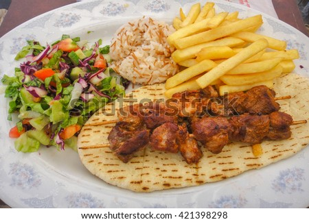 Rice, potato, salad and grilled meat. Cyprus food