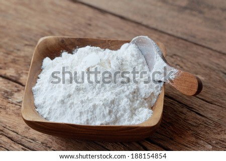 Rice powder in wooden bowl - stock photo