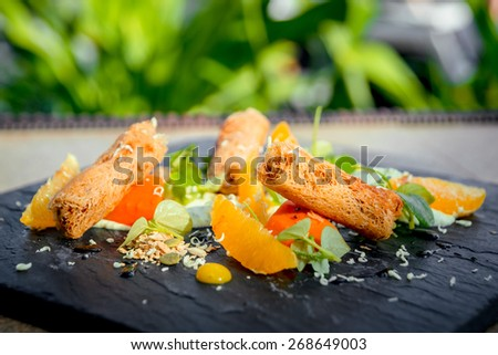 Rice rolls with vegetables on a white plate. The Restaurant