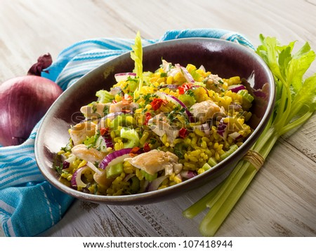 rice salad with chicken celery onions and chili pepper - stock photo