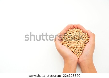 Rice seeds in hands on white background.