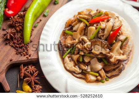 rice served with meat and vegetables on top