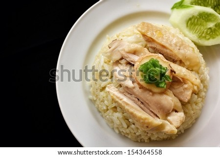 rice steamed with chicken on black background - stock photo