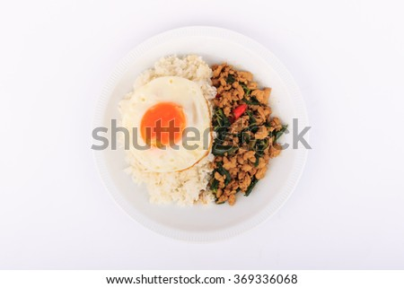 Rice topped with stir-fried chicken, basil and fried egg, fried stir basil with minced chicken on white background (Isolated Background) - stock photo