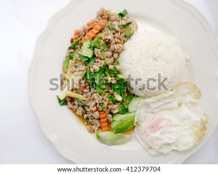 Rice topped with stir-fried minced pork and basil , fired egg., thai food - stock photo