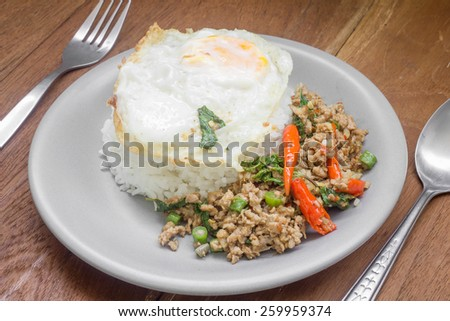 Rice topped with stir fried minced pork and basil. Thai food - stock photo