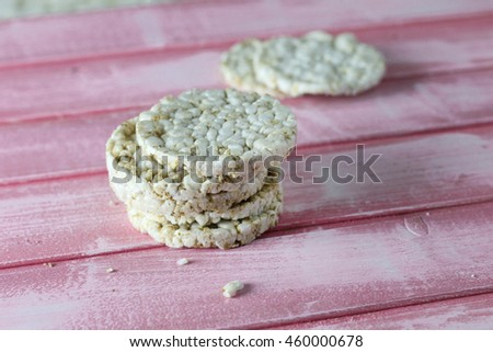 Rice wafers isolated on a pink wooden background - stock photo