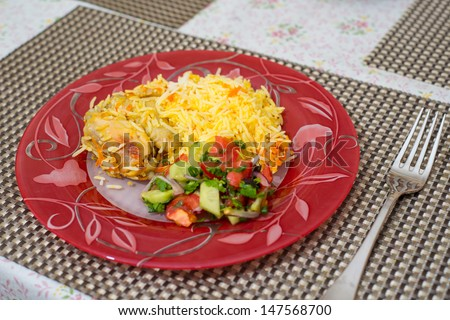 rice with chicken on a dining table - stock photo