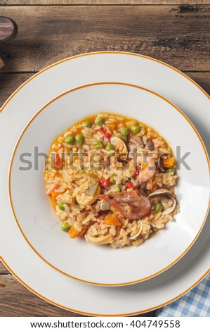 Rice with clams shrimp and squid - stock photo