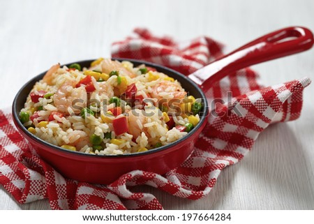 Rice with corn, pea, pepper and shrimps - stock photo