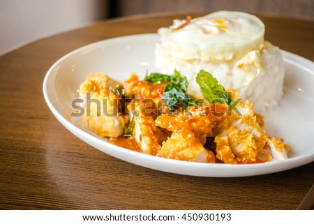 Rice with crispy chicken and fried egg
