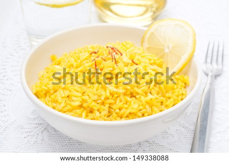 rice with lemon and saffron in the bowl, close-up - stock photo