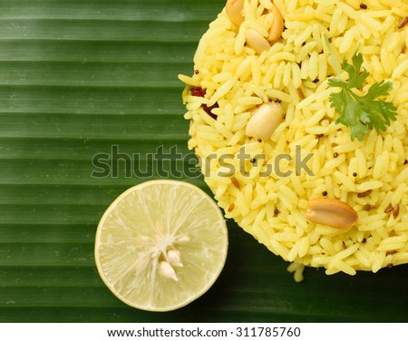 rice with lemon, curry leaf and red chilly in the bowl, close-up - stock photo