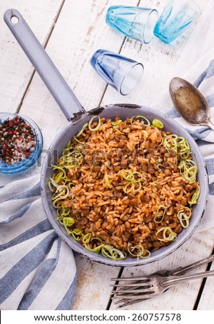 Rice with lentils and leeks.selective focus - stock photo
