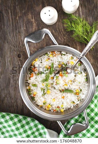 Rice with  mixed vegetables in pan - stock photo