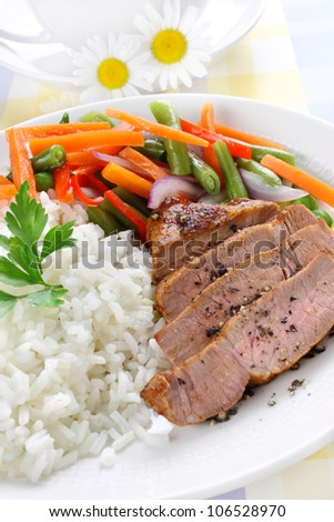 Rice with pork meat and vegetables