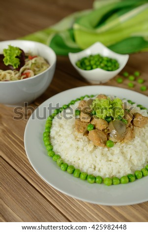 Rice with pork, mushrooms, pea and sauce