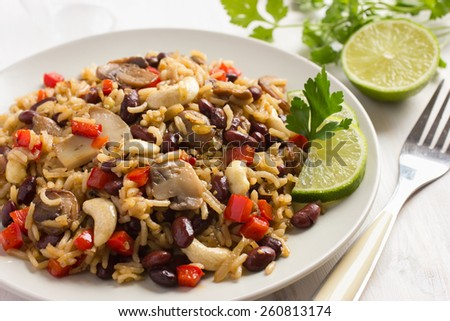 Rice with  red bean, mushrooms and vegetables - stock photo