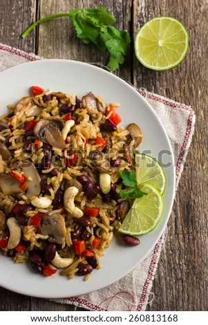 Rice with  red bean, mushrooms and vegetables, top view - stock photo