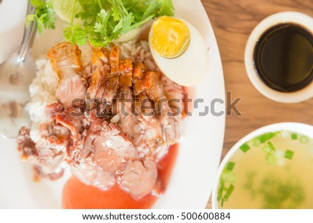 Rice with roasted pork. Sweet boiled eggs as the breakfast menu.