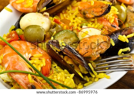 rice with seafood close up in a dish