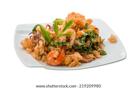 Rice with seafood isolated on white - stock photo