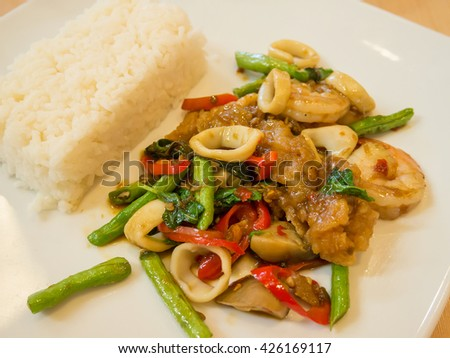Rice with stir-fried seafood and basil, Thai food