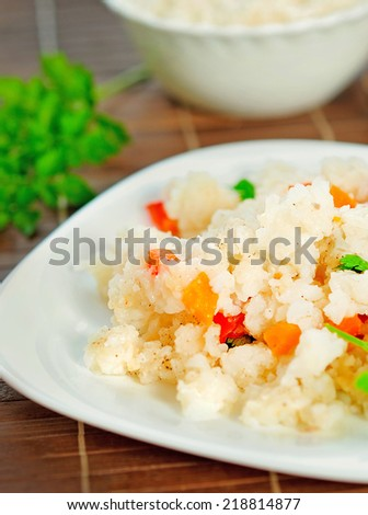 Rice with vegetable on table
