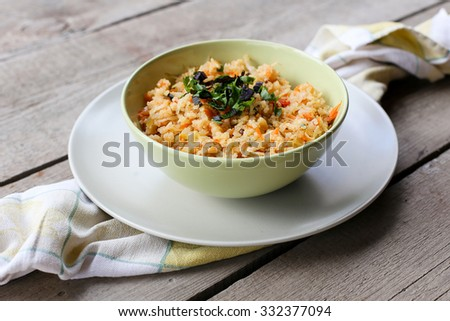 Rice with vegetables on wood table