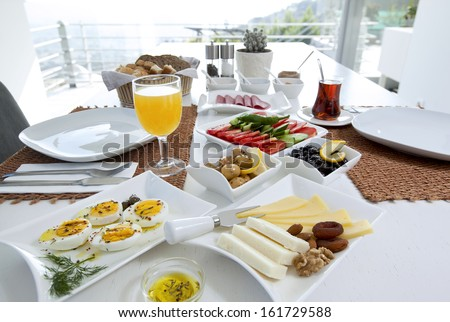 Rich and delicious Turkish breakfast on white wood table - stock photo
