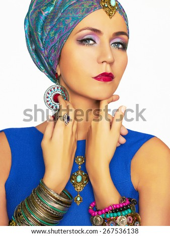 rich beautiful woman in turban and jewelry.fashionable Elegant Lady.Indian queen - stock photo