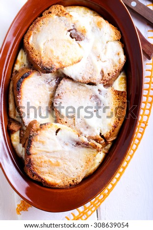 Rich bread and butter pudding: baked fruit cake with egg custard