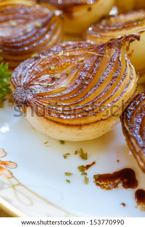 Rich browned golden caramelized balsamic onions roasted in the oven. - stock photo