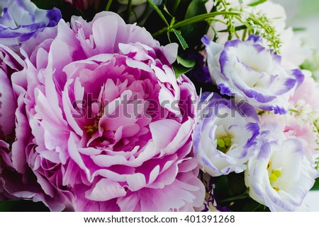 Rich bunch of pink peonies peony and lilac eustoma roses flowers. Rustic style, still life. Fresh spring bouquet, pastel colors. Summer Background.  Macro flower.