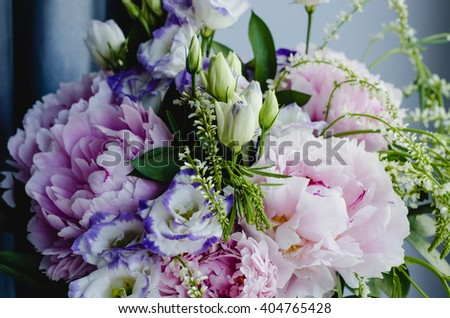 Rich bunch of pink peonies peony and lilac eustoma roses flowers. Rustic style, still life. Fresh spring bouquet, pastel colors. Background.  - stock photo