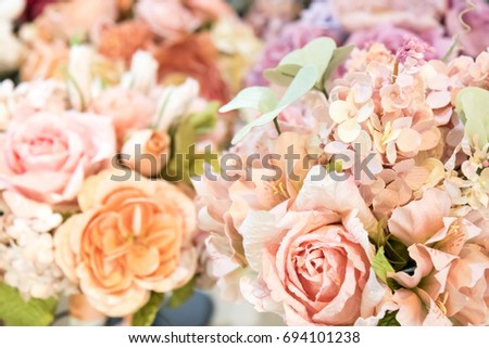 Rich bunch of pink peonies, roses and hydrangea flowers, green leaf in wicker baskets. Fresh spring bouquet. Summer Background. Selective focus.